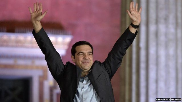Alexis Tsipras greets supporters following victory in the election