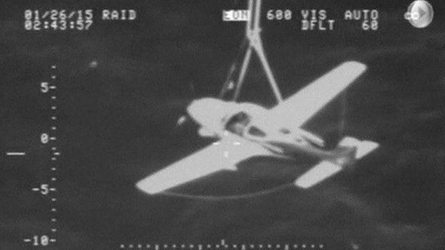 Cirrus SR-22 plane with parachute deployed