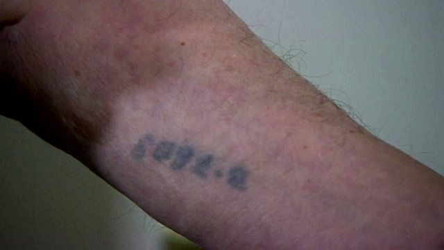 A close-up of Arek Hersh's Auschwitz ID number tattooed onto his arm