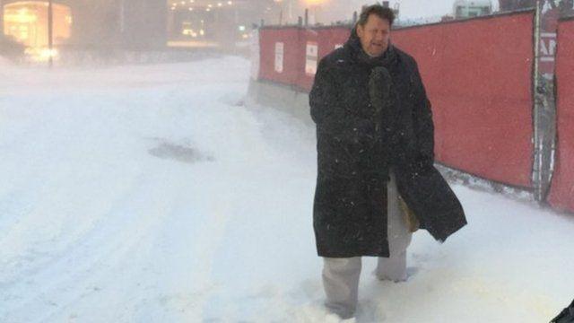 BBC reporter Gary O'Donoghue battles snowy conditions in Boston, MA
