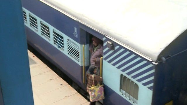 Train with passengers getting off