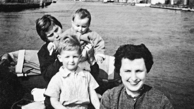 Roger Cohen as a child with his mother and two others on a boat