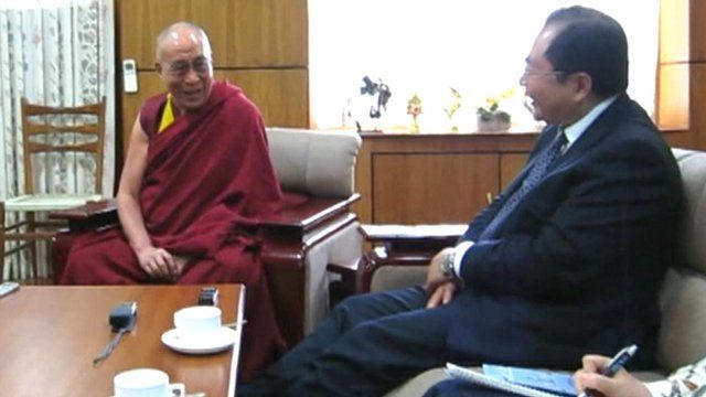 The Dalai Lama (l) with