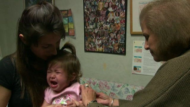 A crying baby having her vaccination