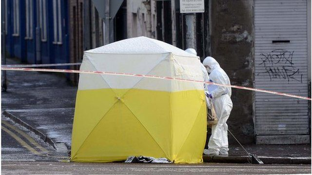 One man has been arrested after a man's body was found at Botanic Avenue in Belfast