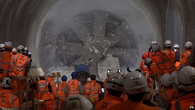 "Workmen look on as tunnel machine, named Elizabeth after the Queen, to break through into the east end of Crossrail""s Liverpool Street station in London"