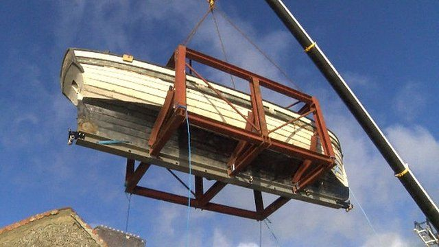 Archaeologists move 'world's oldest yacht'