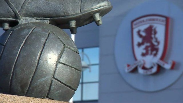 Middlesbrough club logo and statue outside ground