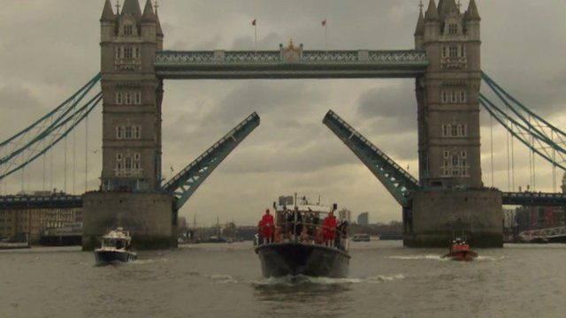 Boat passes under Tower Bridge