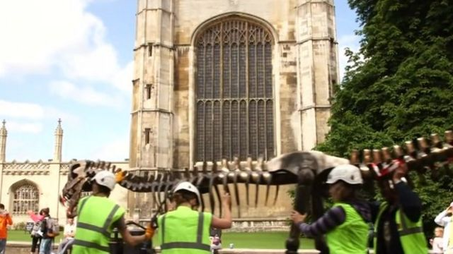 T-rex model carried before King's College, Cambridge