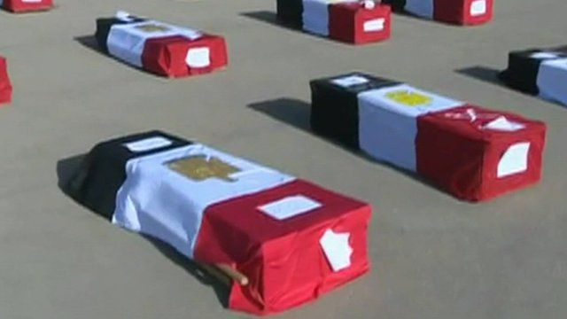Coffins draped in Egyptian flags