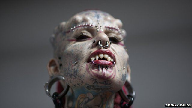 Mary Jose Cristerna, a Mexican known as The Vampire Woman, poses for the public to take portraits of her during the annual Venezuela Tattoo International Expo in Caracas, Venezuela