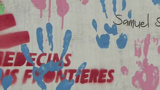 Close up of handprints in paint on an Ebola survivors' mural in an MSF centre in the Liberian capital, Monrovia