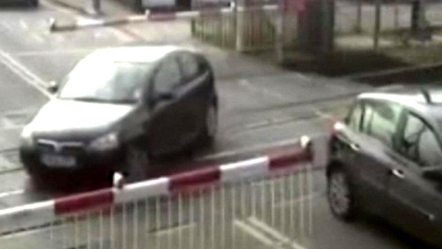 A car in the middle of a level crossing