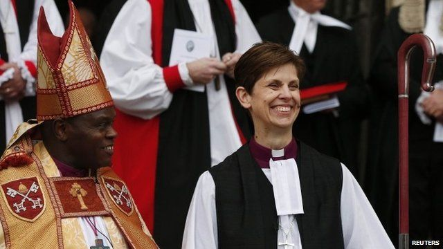 The first female bishop in the Church of England, Libby Lane, steps outside following her consecration service at York Minster