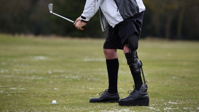 Man plays golf while using a bionic leg brace
