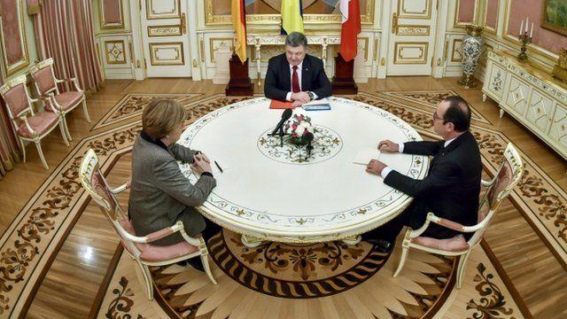 Ukrainian President Petro Poroshenko (top), German Chancellor Angela Merkel (L) and French President Francois Hollande during their talks in Kiev on February 5, 2015