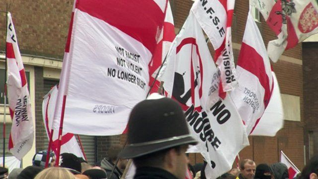 Flags with EDL slogans at an EDL protest in Dudley