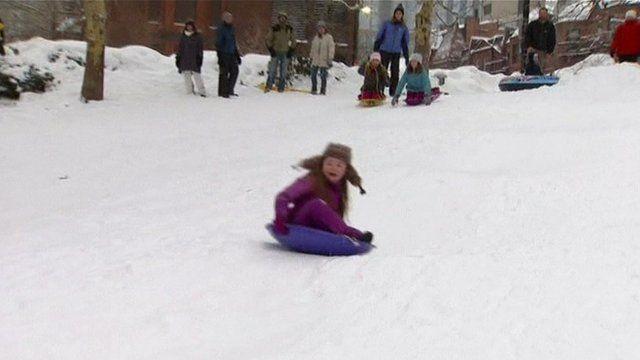 A girl on a sledge