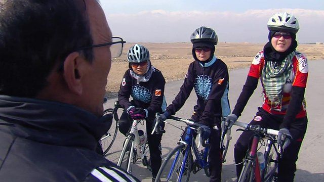 Coach with three cyclists
