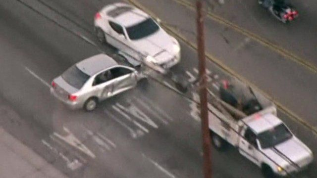 Armed man in car crashes into another vehicle