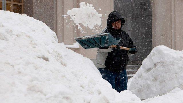 Person shovels show in Boston