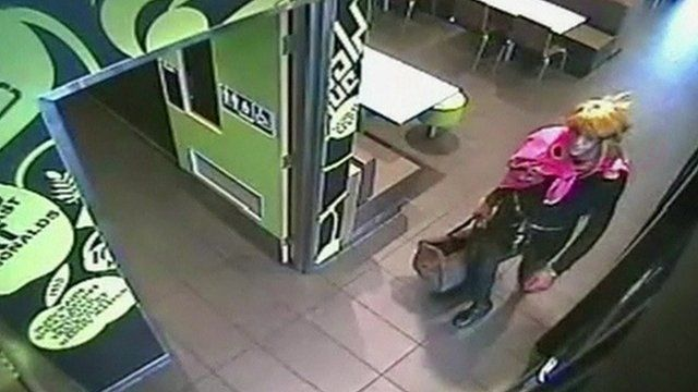 CCTV footage of a cross dressing robber
