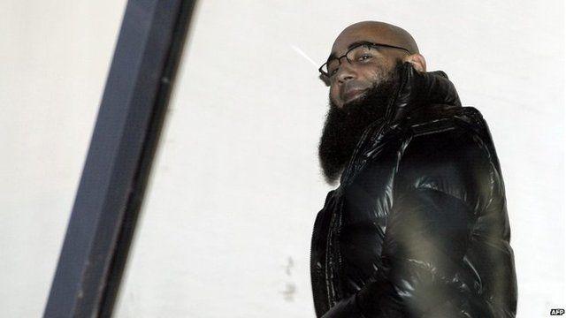 File photo: Fouad Belkacem smiles at Antwerp criminal court, 30 November 2012