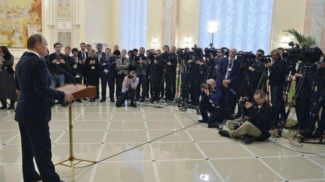 Vladimir Putin speaks to reporters after summit in Minsk, 12 February