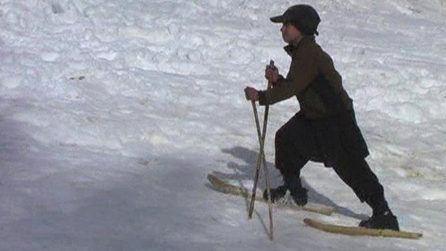Boy on homemade skis