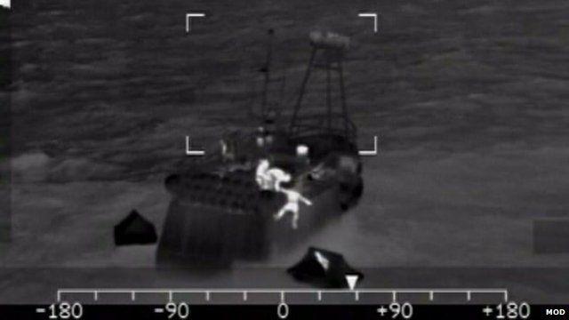 Fishermen jump into life-raft