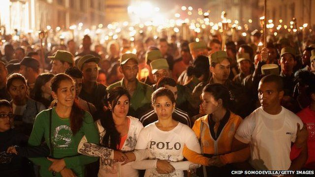 Young Cuban students walk arm in arm during the March of the Torches from the University of Havana on 27 January 2015 in Havana, Cuba