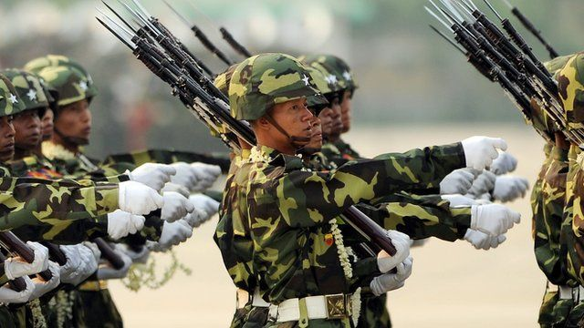 Myanmar soldiers take part in a military parade marking the 65th Armed Forces Day in Nay Pyi Daw on 27 March 2010