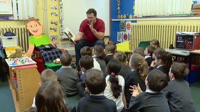 Man reading to schoolchildren