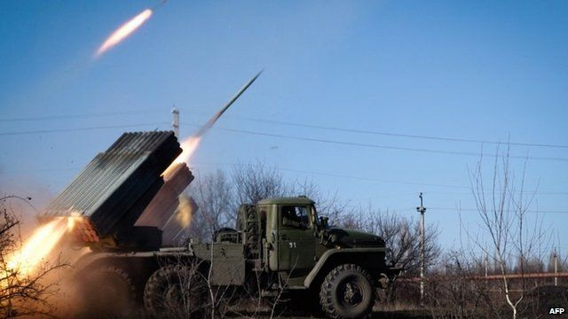 Pro-Russian rebels in the Donetsk region launch missiles from a Grad launch vehicle - 13 February 2015