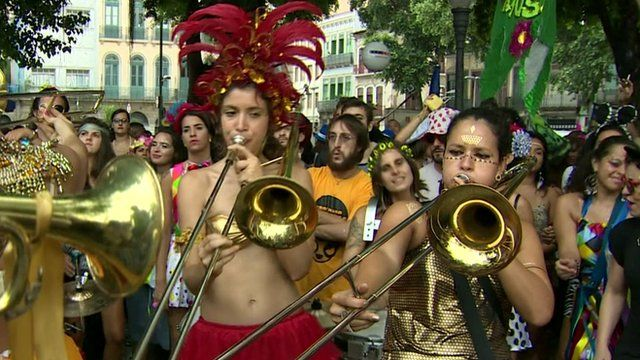 A women's brass band plays during a carnival parade