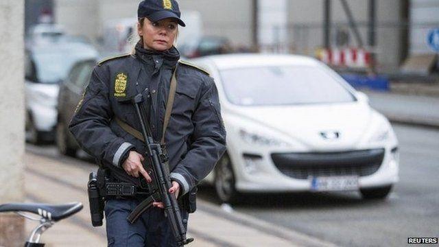 Policewoman in Copenhagen after the shootings.