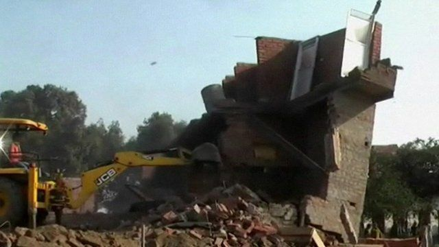 Thirteen people have died after a building collapsed in India's Uttar Pradesh state