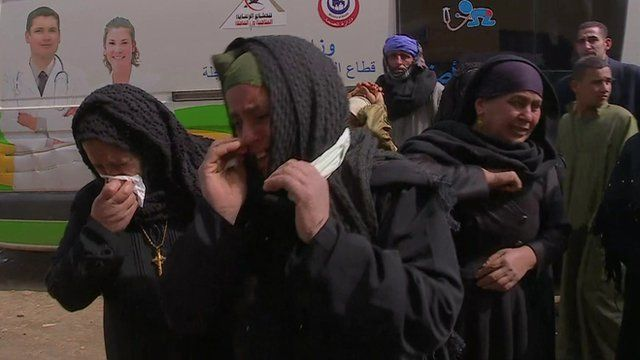 Coptic Christian women mourn the loss of their relatives