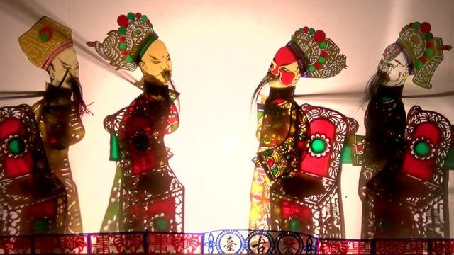 A Chinese shadow puppet show.