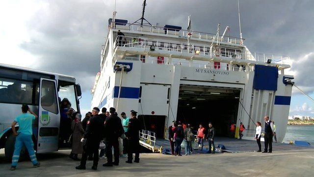 New EU migrants being moved from Lampedusa by ferry to other parts of Italy