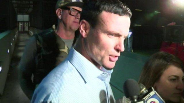 Vanilla Ice talks to reporters outside