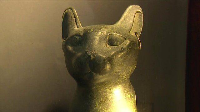Ancient Egyptian bronze cat bust