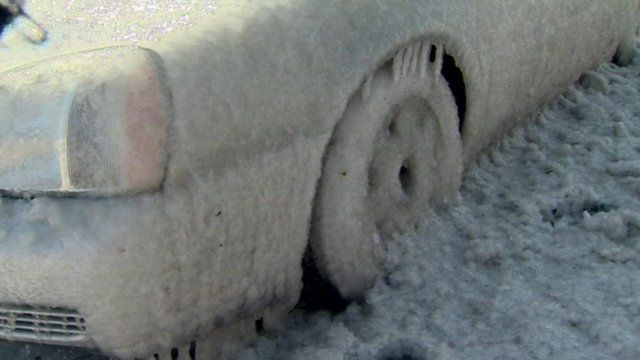 A car frozen to the road