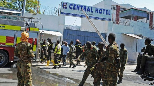 Somali security forces, paramedics and fire fighters outside the Central Hotel in Mogadishu on 20 February 2015