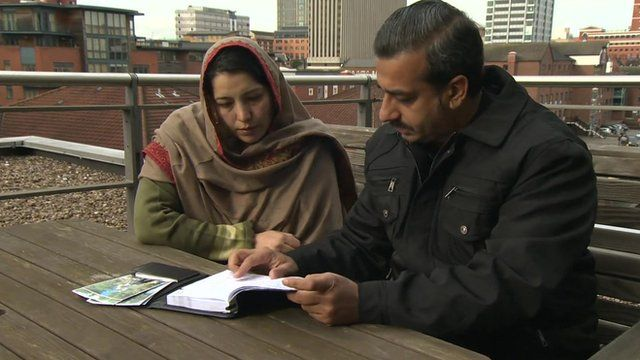 Ahmad Nawaz's parents, Samina and Muhammad look at a written account by their son of how he survived Taliban school attack