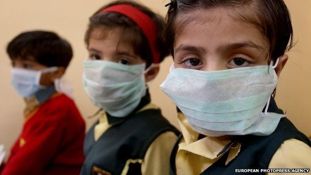 Indian school children in protective face masks
