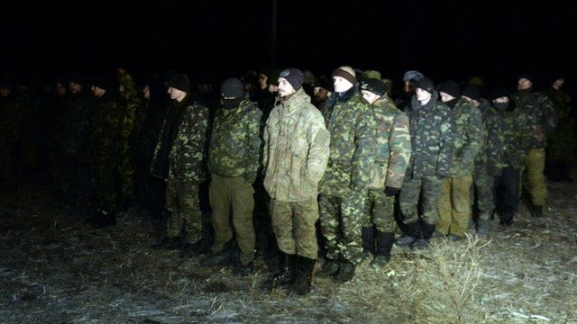 Ukrainian prisoners of war stand during a prisoner exchange with Ukraine on February 21, 2015 in the eastern Ukrainian city of Frunze near Lugansk