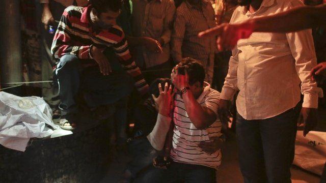 Bangladeshi relatives wail near bodies of victims