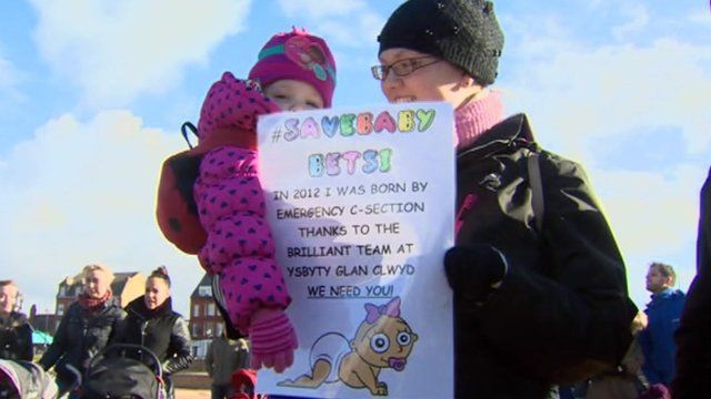 Mother and child at maternity care protest